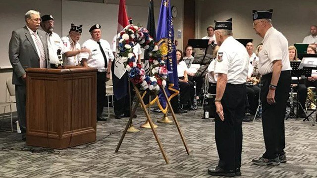 Members of the Korean War Veterans Association Chapter 6, lay a wreath to remember fallen service members at a Memorial Day ceremony in St. Charles, MO (Credit: KMOV)