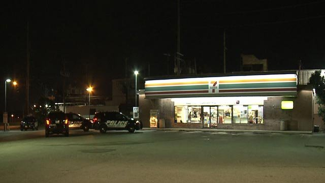 Police outside a Granite City 7-Eleven following an armed robbery Tuesday (Credit: KMOV)