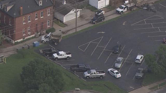 A stolen dump truck went through a St. Louis parking lot Wednesday (Credit: KMOV)