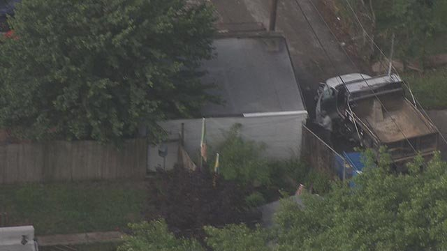 The driver jumped out of a stolen dump truck in St. Louis Wednesday (Credit: KMOV)