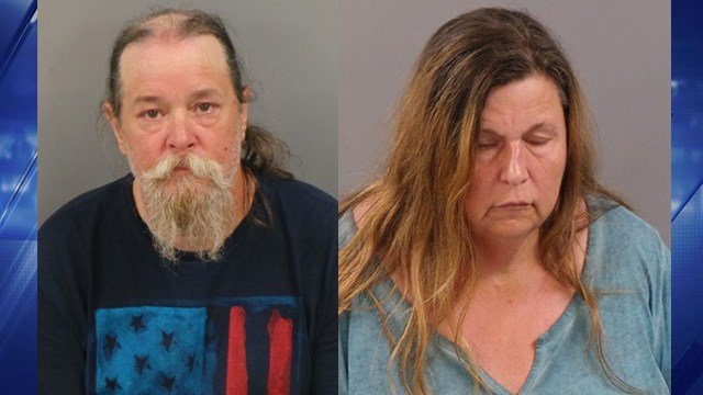 Sharon Kibbee and Michael Jones of Richwoods are charged with 13 counts of animal abuse after they left 13 dogs in a hot, abandoned car in Ellisville early this month. (Credit: Ellisville PD)