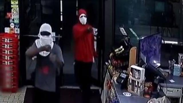 Two suspects entered a Granite City 7-Eleven for an armed robbery on May 19, 2018 (Credit: Granite City Police / Facebook)