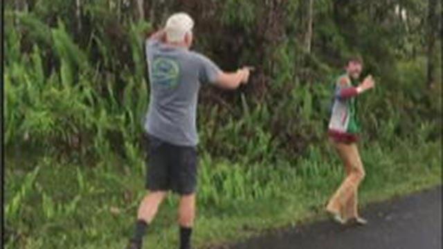 Video shows 61-year-old John Hubbard pulling a gun on his neighbor.  (Credit: Ethan O Edwards  via CBS News)