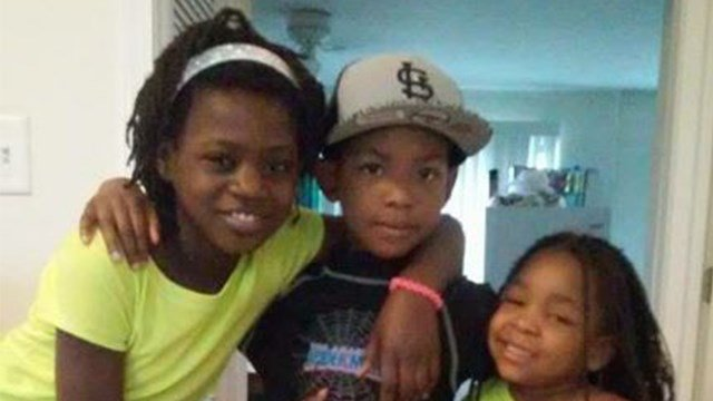 Dashawn Stiles (middle) was trapped in the fire, along with his two sisters.