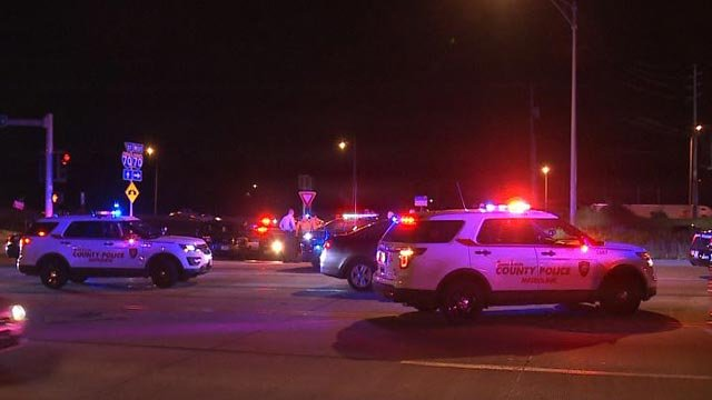 Multiple police vehicles at the scene of the end of a pursuit (Credit: KMOV)