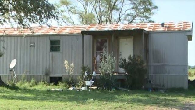The Arkansas home where a 1-month-old was found dead (Credit: WREG via CBS News)