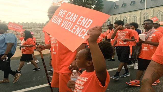 undreds of St. Louisians donned bright orange to march for gun violence awareness along in North St. Louis ( Credit:KMOV)