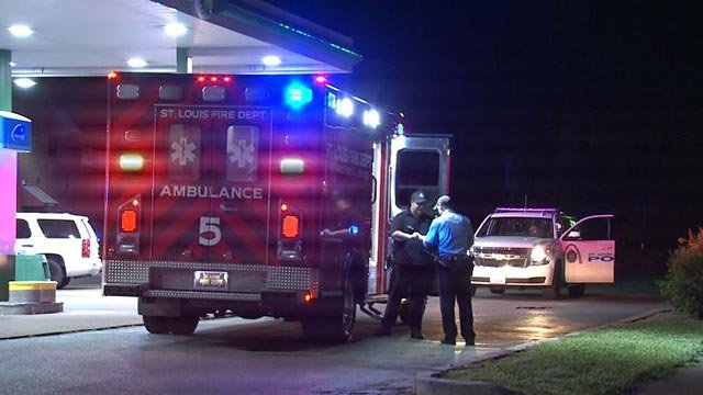 An officer receiving treatment after sustaining a hand injury early Monday (Credit: KMOV)