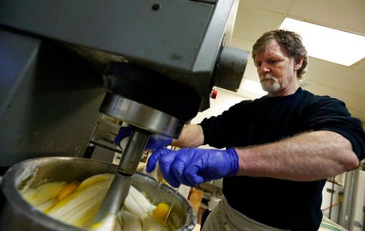 In this March 10, 2014 file photo, Masterpiece Cakeshop owner Jack Phillips cracks eggs into a cake batter mixer inside his store in Lakewood, Colo. (AP Photo)