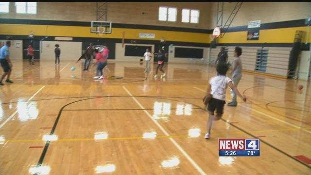 St. Louis County police officers took on kids on the basketball court on  Monday. Credit: KMOV