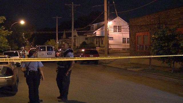 Police in the 4300 block of Wallace after a man was shot dead Monday night (Credit: KMOV)