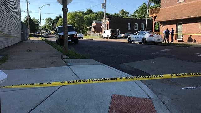 Police on West Davis after a fatal shooting Wednesday (Credit: KMOV)