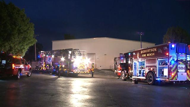 Firefighters on Northwest Industrial Drive after a Friday morning fire (Credit: KMOV)