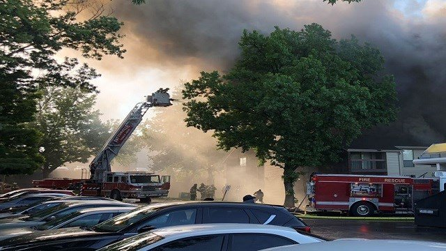 Multiple fire crews have responded to a four-alarm apartment complex fire. (Credit: KMOV)