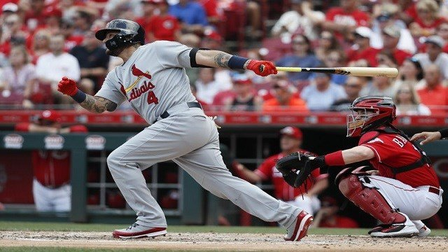 St. Louis Cardinals' Yadier Molina hits a three-run double off Cincinnati Reds starting pitcher Luis Castillo in the third inning of a baseball game, Saturday, June 9, 2018, in Cincinnati. (AP Photo/John Minchillo)