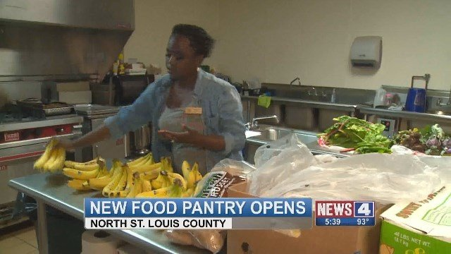 A volunteer preps fresh food at Fit and Food Connection's new center. (Credit: KMOV)