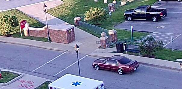 The suspect was last seen leaving in a small maroon, two-door vehicle with tinted windows and cleat coat peeling from the hood. (Credit: Alton PD)