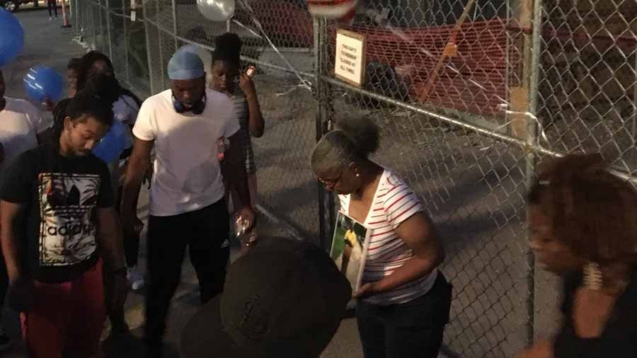 Family members of Ben Ricks, who is one of the two men killed after falling six stories at a construction site, gathered Monday night to demand answers. Credit: KMOV