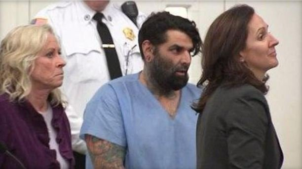 Christopher Fratantonio (center), appears in a Barnstable, Massachusetts courtroom on February, 28, 2017, after police accused him of stabbing his wife to death and sending her friends photos of her corpse.  (Credit: CBS BOSTON)