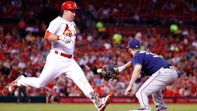 St. Louis Cardinals' Jedd Gyorko, left, arrives too late at first on his grounder as San Diego Padres first baseman Eric Hosmer handles the throw during the fifth inning of a baseball game Tuesday, June 12, 2018, in St. Louis. (AP Photo/Jeff Roberson)
