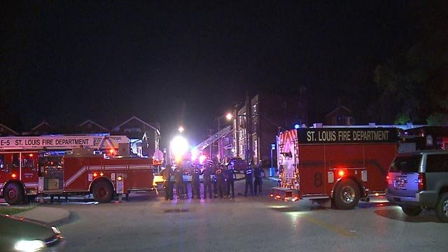 Firefighters in the area of Lillian and Kingshighway during a two-alarm fire Tuesday (Credit: KMOV)