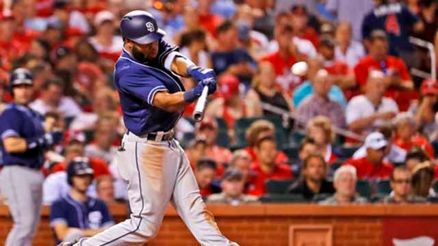 San Diego Padres' Manuel Margot hits an RBI triple during the sixth inning of a baseball game against the St. Louis Cardinals Wednesday, June 13, 2018, in St. Louis. (AP Photo/Jeff Roberson)