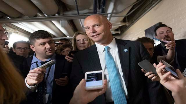 Reporters pursue Marc Short, the White House legislative liaison, as House Republicans try to bridge their party's internal struggle over immigration at a closed-door meeting on Capitol Hill in Washington, Thursday,(Credit: AP Photo/J. Scott Applewhite)