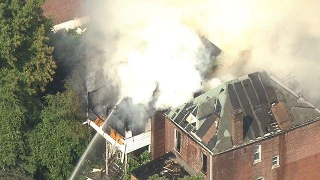 Firefighters extinguishing a blaze in North City Friday (Credit: KMOV)