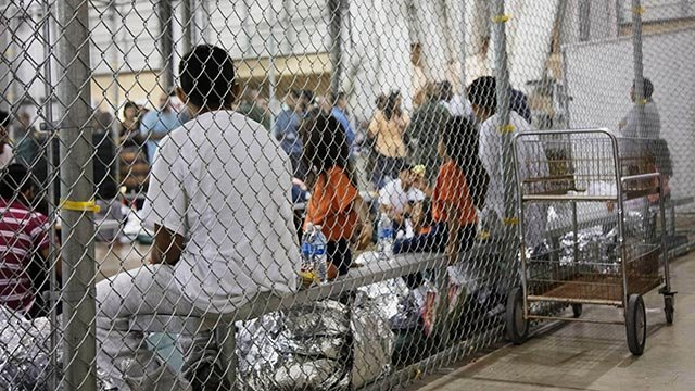 People who've been taken into custody related to cases of illegal entry into the United States, sit in one of the cages at a facility in McAllen, Texas. (U.S. Customs and Border Protection's Rio Grande Valley Sector via AP)