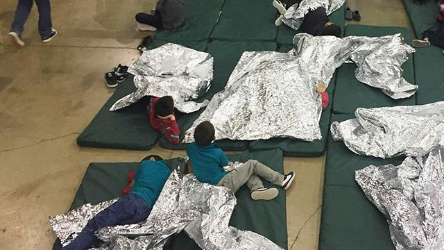People who've been taken into custody related to cases of illegal entry into the United States, rest in one of the cages at a facility in McAllen, Texas. (U.S. Customs and Border Protection's Rio Grande Valley Sector via AP)