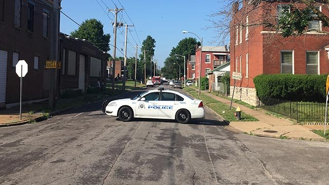 A St. Louis police cruiser at the end of a road while a standoff  is underway in the 3800 block of Greer (Credit: KMOV)