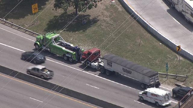 A semi-truck being towed away after a crash Tuesday morning (Credit: KMOV)