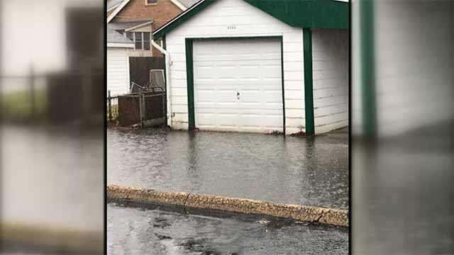 Gretchen Jenson says she and her neighbors are frustrated about the flooding problem that covers a section of an alleyway behind Goethe Avenue near Hampton Avenue. Credit: KMOV