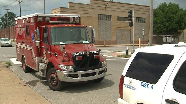An ambulance on the scene after a man and woman were attacked by dogs (Credit: KMOV)