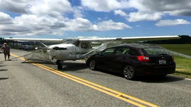 The plane crash-landed on a two-lane road, narrowly missing a moving car. (Credit KIRO/CNN)