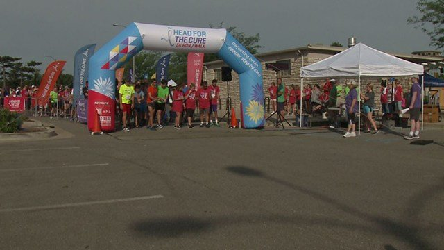 Runners of the Head for the Cure 5k marathon wait to start running. (Credit: KMOV)