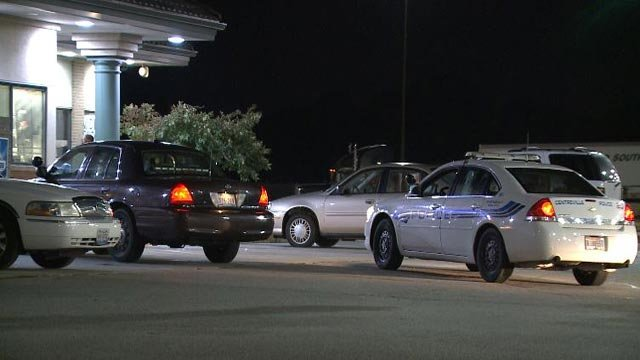 Police outside the Flying J Truck Stop on Race Horse Drive after an officer was dragged by a suspect vehicle Wednesday (Credit: KMOV)