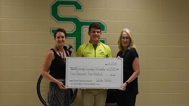 Wade Hahn & Brandy Henderson presenting a check to Mary Burton (Credit: Erika Hahn)