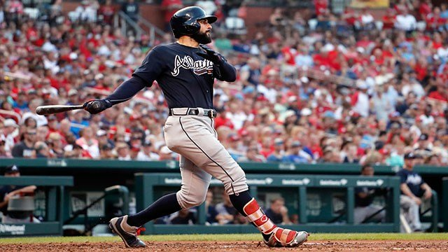 Atlanta Braves' Nick Markakis follows through on a grand slam during the fifth inning of the team's baseball game against the St. Louis Cardinals on Saturday, June 30, 2018, in St. Louis. (AP Photo/Jeff Roberson)