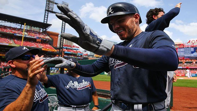 Freddie Freeman #5 of the Atlanta Braves is congratulated after hitting a two-run home run against the St. Louis Cardinals in the sixth inning at Busch Stadium on July 1, 2018 in St. Louis, Missouri. (Photo by Dilip Vishwanat/Getty Images)