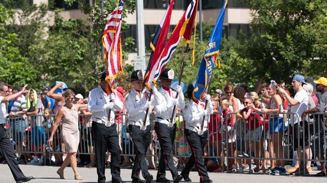 Firefighters march in the America's Birthday Parade in downtown St. Louis. Credit: Daniel Martinez