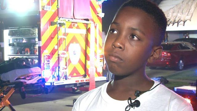 Darwin Wallace, 12, is credited with saving his family from a house fire (Credit: KMOV)