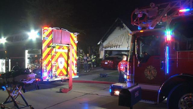 Firefighters in the 3800 block of Kentucky Derby (Credit: KMOV)