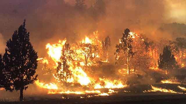 In this photo released Friday, July 6, 2018, by the California Highway Patrol, the Klamathon Fire burns in Hornbrook, Calif. (Credit: AP)