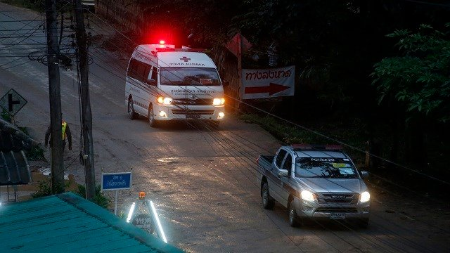 One of two ambulances leave the cave in northern Thailand hours after operation began to rescue the trapped youth soccer players and their coach, in Mae Sai, Chiang Rai province, in northern Thailand, Sunday, July 8, 2018. (Credit: AP Photo/Sakchai Lalit)