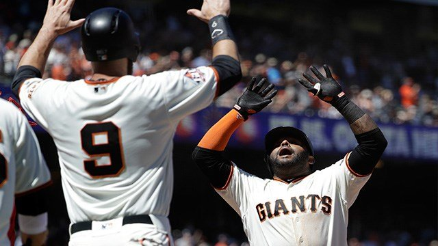 San Francisco Giants' Pablo Sandoval, right, celebrates his three-run home run at home plate with teammate Brandon Belt (9) during the fifth inning of a baseball game against the St. Louis Cardinals, Sunday, July 8, 2018, in San Francisco. (AP Photo/Marci