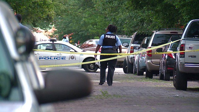 Police process the scene where a man was gunned down in South St. Louis (Credit: KMOV)