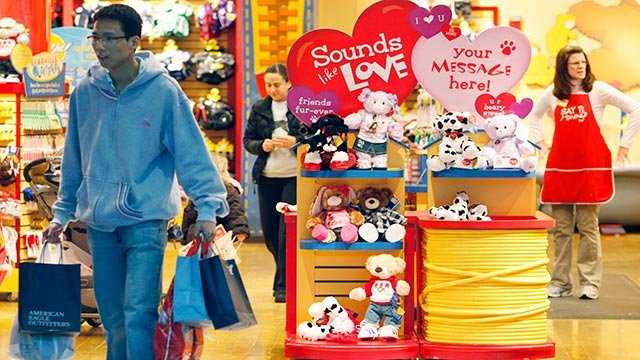 A shopper leaves the Build-A-Bear store at South Shore Plaza in Braintree, Mass., Wednesday, Feb. 10, 2010. (Credit: AP Photo / Michael Dwyer)