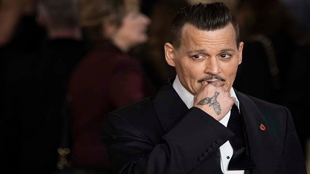 Actor Johnny Depp poses for photographers upon arrival at the world premiere of the film 'Murder on the Orient Express', in London, Thursday, Nov. 2, 2017. (Photo by Vianney Le Caer/Invision/AP)