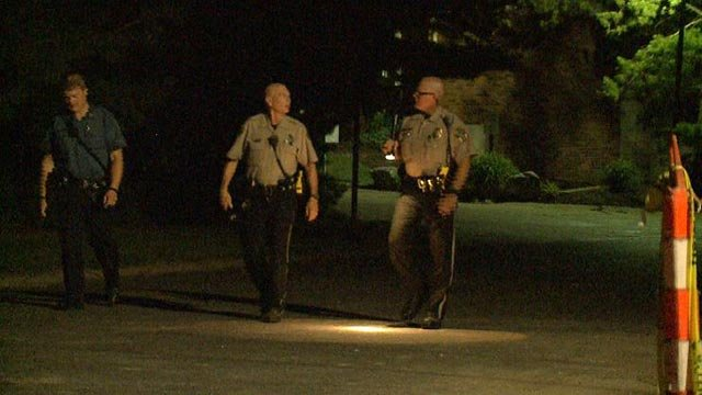 Officers searching an area of Fee Fee Road after a pursuit ended Wednesday (Credit: KMOV)